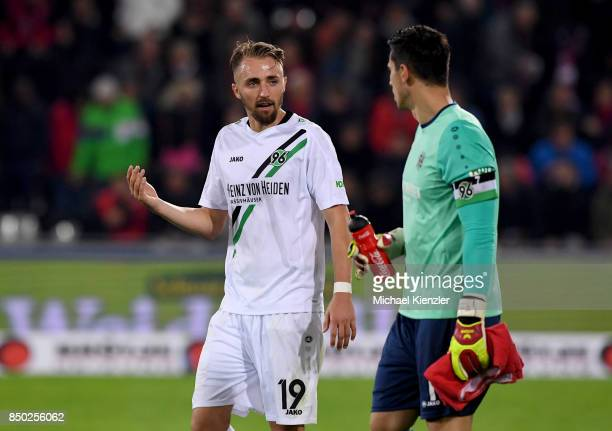 Florian Huebner and Philipp Tschauner of Hannover 96 discuss during the Bundesliga match between Sport Club Freiburg and Hannover 96 at...