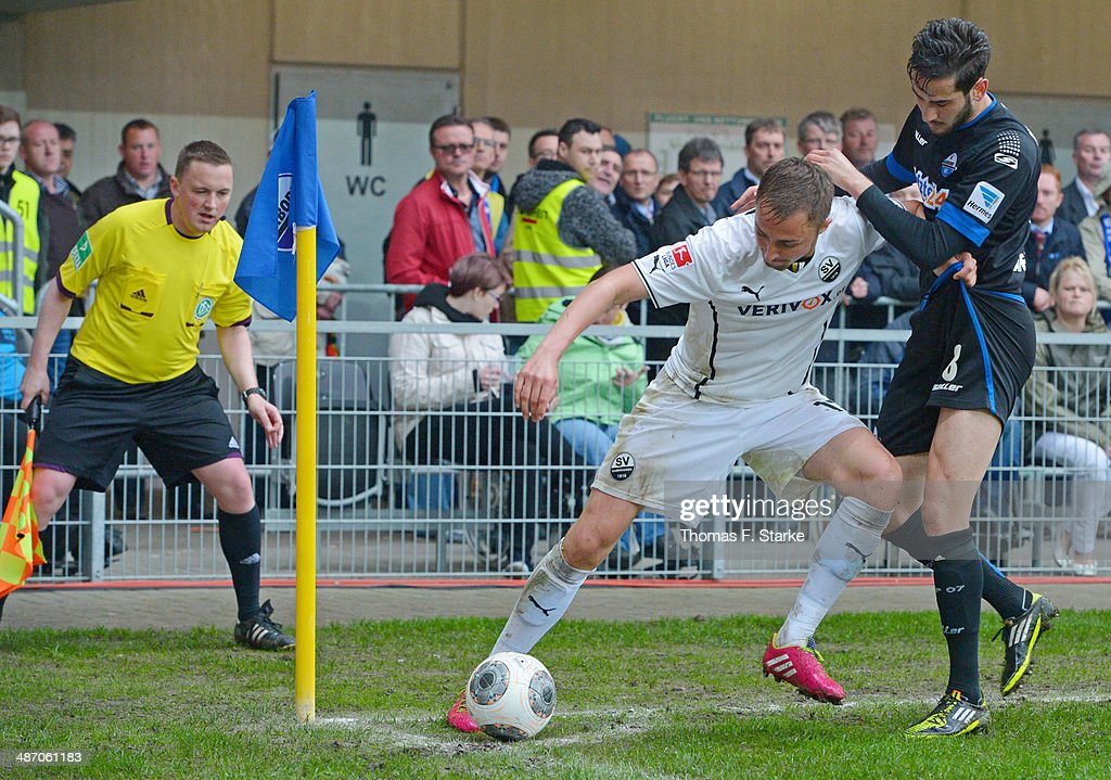 Florian Huebner (2nd R) of Sandhausen and Mario Vrancic (R) of Paderborn fight for the ball during the Second Bundesliga match between SC Paderborn and SV Sandhausen at Benteler Arena on April 27, 2014 in Paderborn, Germany.