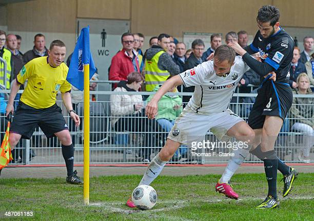 Florian Huebner of Sandhausen and Mario Vrancic of Paderborn fight for the ball during the Second Bundesliga match between SC Paderborn and SV...