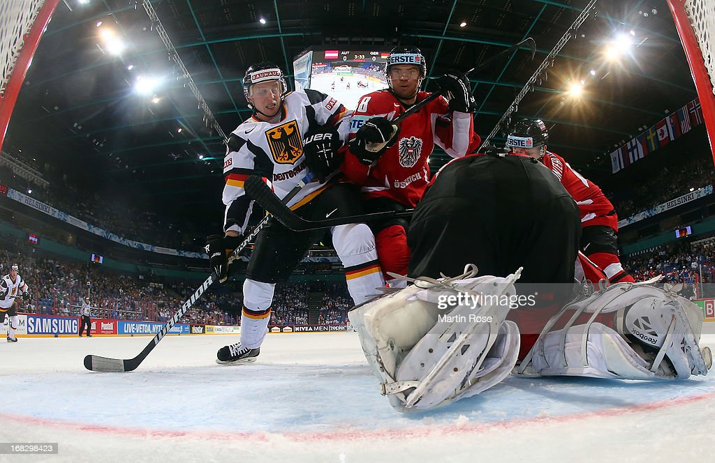 Florian Iberer (#48) of Austria baatles for position with Michael Wolf (#16) of Germany in front of the net during the IIHF World Championship group H match between Austria and Germany at Hartwall Areena on May 8, 2013 in Helsinki, Finland.