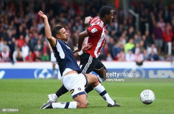 Florian Jozefzoon of Brentford is challenged by James Meredith of Millwall during the Sky Bet Championship match between Brentford and Millwall at...