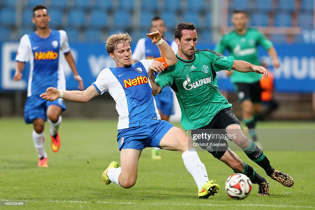 Florian Jungwirth of Bochum challenges Christian Fuchs of Schalke during the pre-season friendly match between VfL Bochum and FC Schalke 04 at Rewirpower Stadium on August 5, 2014 in Bochum, Germany.