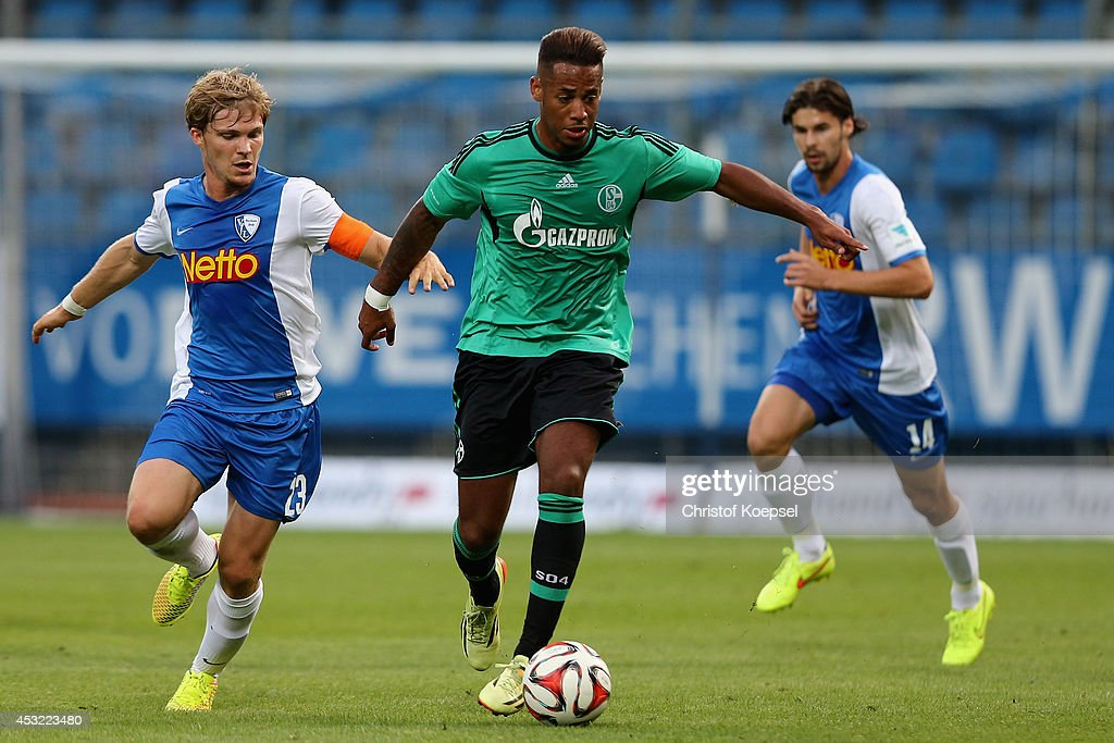 Florian Jungwirth of Bochum challenges Dennis Aogo of Schalke of Schalke runs with the ball during the pre-season friendly match between VfL Bochum and FC Schalke 04 at Rewirpower Stadium on August 5, 2014 in Bochum, Germany.