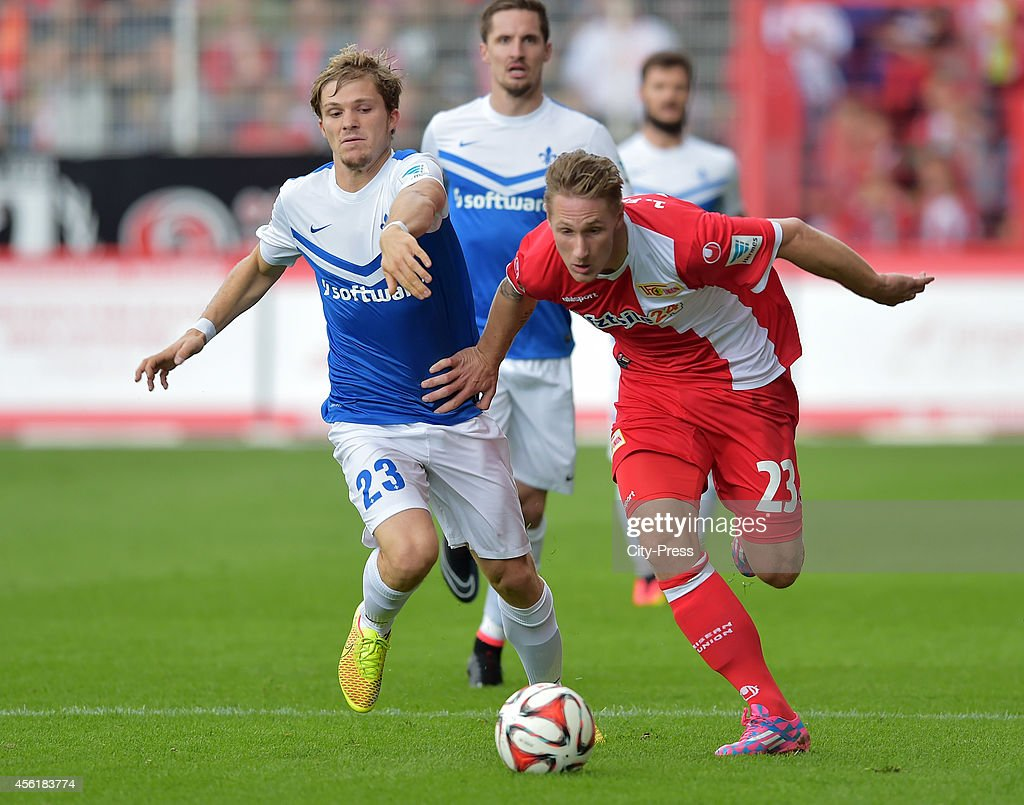 Florian Jungwirth of SV Darmstadt 98 and Sebastian Polter of 1 FC Union Berlin in action during the game between 1 FC Union Berlin and SV Darmstadt...