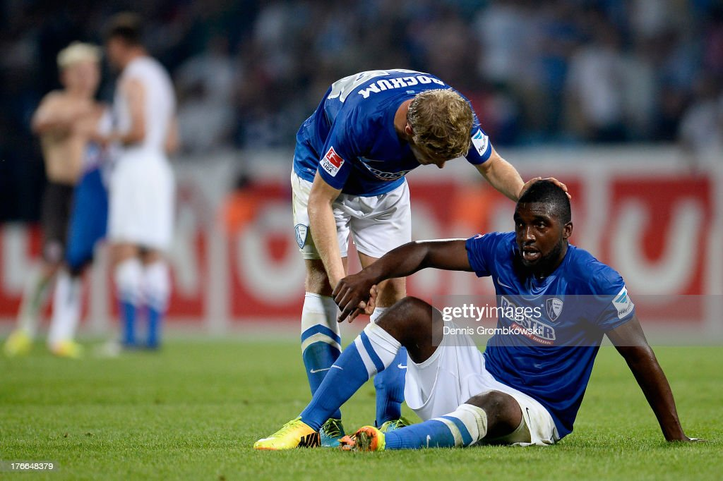 Florian Jungwirth of VfL Bochum interacts with teammate Richard Sukuta Pasu after the Second Bundesliga match between VfL Bochum and FC St Pauli at...