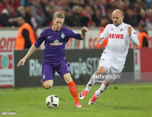 Florian Kainz of Bremen and Konstantin Rausch of Koeln battle for the ball during to the Bundesliga match between 1 FC Koeln and Werder Bremen at...