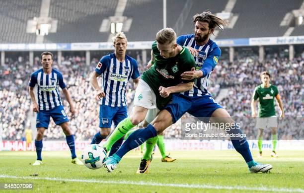 Florian Kainz of SV Werder Bremen is challenged by Marvin Plattenhardt of Hertha BSC during the Bundesliga match between Hertha BSC and SV Werder...
