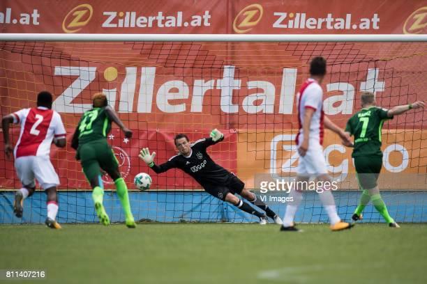 Florian Kainz of SV Werder Bremen scores a penalty against goalkeeper Norbert Alblas of Ajax during the friendly match between Ajax Amsterdam and SV...