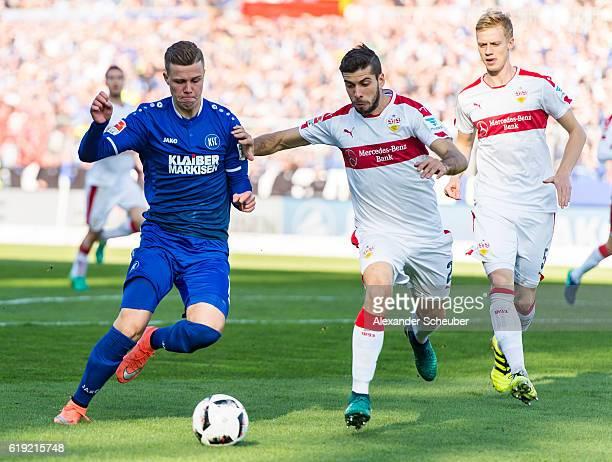 Florian Kamberi of Karlsruhe challenges Emiliano Insua of Stuttgart during the Second Bundesliga match between Karlsruher SC and VfB Stuttgart at...