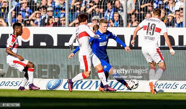 Florian Kamberi of Karlsruhe challenges Takuma Asano of Stuttgart and Kevin Grosskreutz of Stuttgart during the Second Bundesliga match between...