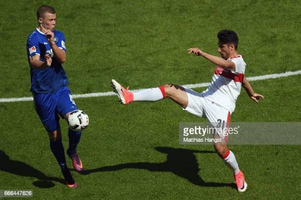 Florian Kamberi of Karlsruhe is challenged by Berkay Oezcan of Stuttgart during the Second Bundesliga match between VfB Stuttgart and Karlsruher SC...