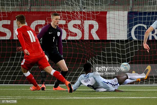 Florian Kamberi of Switzerland U21 scores a goal against goalkeeper Jordan Pickford and Dominic Iorfa of England U21 during the European Under 21...