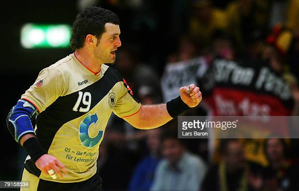 Florian Kehrmann of Germany celebrates after scoring a goal during the Men's Handball European Championship main round Group II match between Germany...