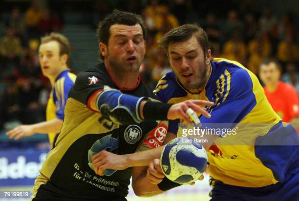 Florian Kehrmann of Germany in action with Jonas Kallman of Sweden during the Men's Handball European Championship main round Group II match between...