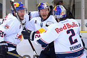 Florian Kettemer Keith Aucoin and Jeremy Dehner of EHC Red Bull Muenchen celebrate after scoring the 34 during the game between the Grizzlys...