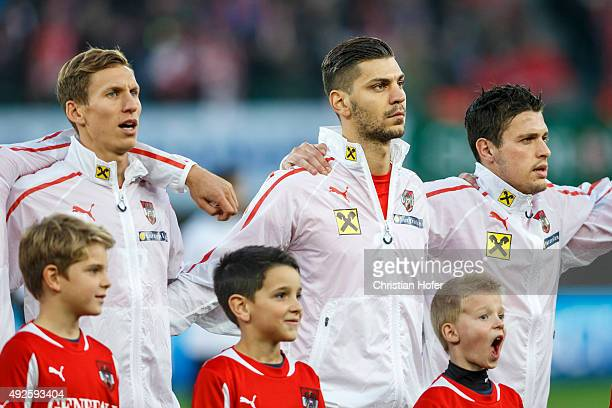 Florian Klein Aleksandar Dragovic and Zlatko Junuzovic of Austria line up during the national anthem prior to the UEFA EURO 2016 Qualifier between...