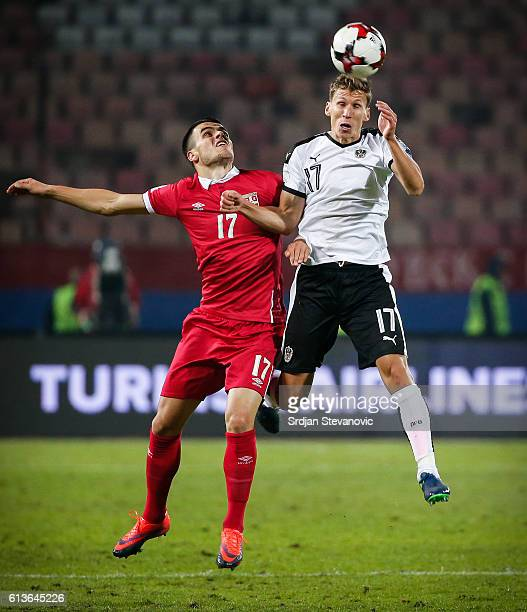 Florian Klein of Austria jump for the ball against Filip Kostic and Stefan Mitrovic of Serbia during the FIFA 2018 World Cup Qualifier between Serbia...