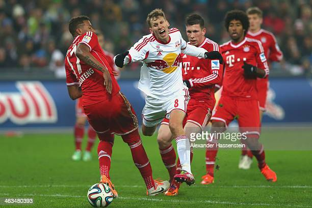 Florian Klein of Salzburg battle for the ball with Jerome Boateng of Bayern Muenchen and his team mates Pierre Emil Hojbjerg and Dante during the...