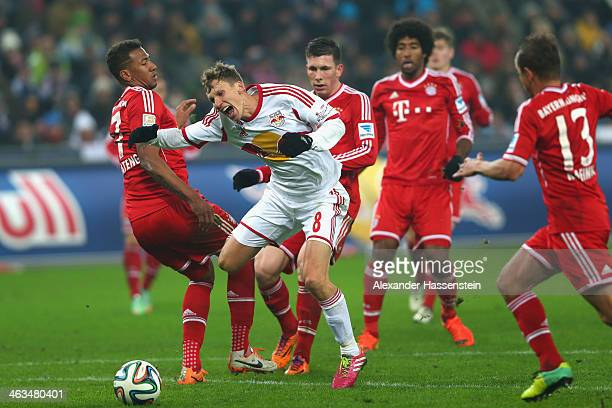 Florian Klein of Salzburg battle for the ball with Jerome Boateng of Bayern Muenchen and his team mates Pierre Emil Hojbjerg Dante and Rafinha during...