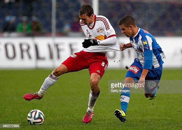 Florian Klein of Salzburg challenges Lukas Denner of Vienna during the tipp3 Bundesliga match between Red Bull Salzburg and SC Wiener Neustadt at Red...