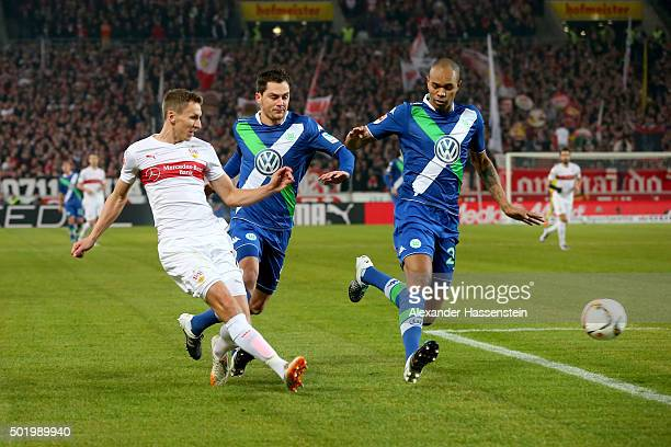 Florian Klein of Stuttgart battles for the ball with Marcel Schaefer of Wolfsburg and his team mate Naldo during the Bundesliga match between VfB...