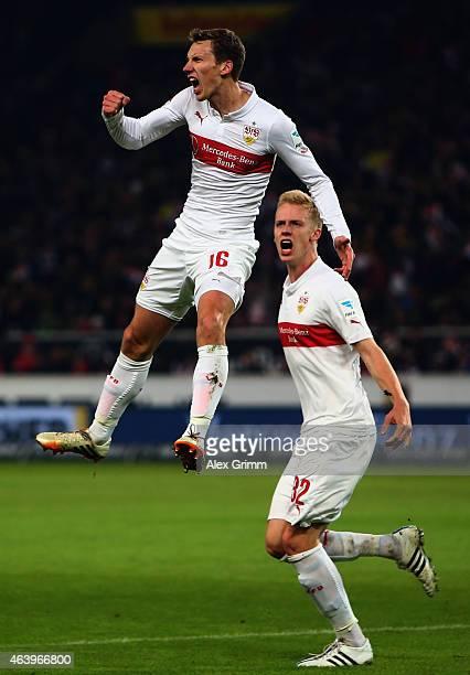 Florian Klein of Stuttgart celebrates his team's first goal with team mate Timo Baumgartl during the Bundesliga match between VfB Stuttgart and...