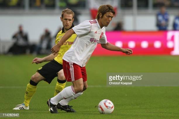 Florian Kringe of Dortmund challenges Takahito Soma of Japan during the charity match between Borussia Dortmund and a Team of Japan at the...