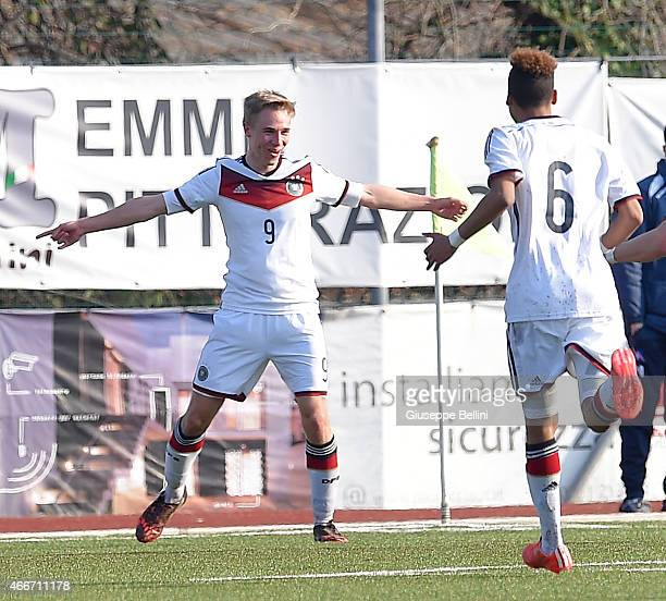 Florian Kruger with his teammates of Germany celebrates after scoring the second team's goal during the international friendly match between U16...