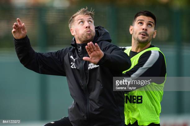 Florian Lejeune and Aleksandar Mitrovic jostle to head the ball during the Newcastle United Training session at the Newcastle United Training ground...