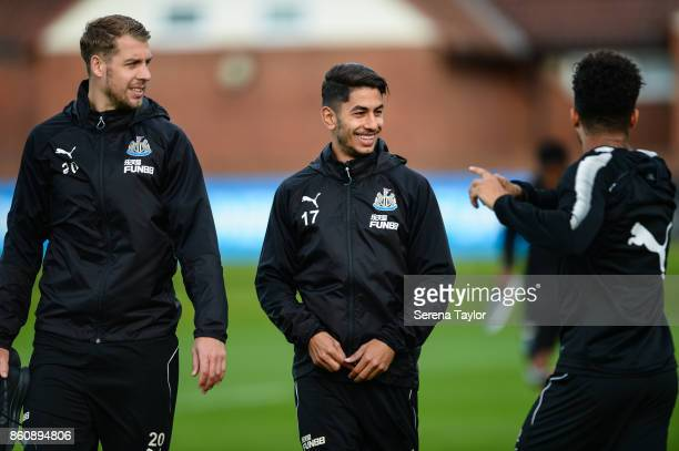 Florian Lejeune and Ayoze Perez smiles as DeAndre Yedlin shares a joke as they walk outside during the Newcastle United Training session at the...