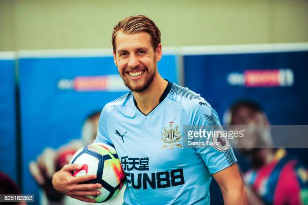 Florian Lejeune holds a ball laughing during the Newcastle United Media Photo Call Day at the Newcastle United Training ground on July 31 in...