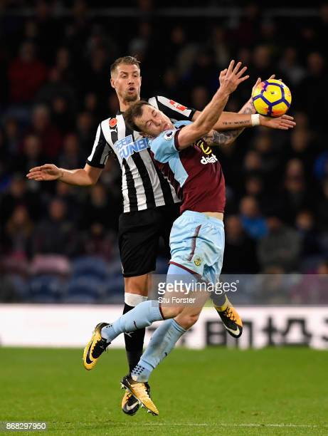 Florian Lejeune of Newcastle United and Ashley Barnes of Burnley clash during the Premier League match between Burnley and Newcastle United at Turf...
