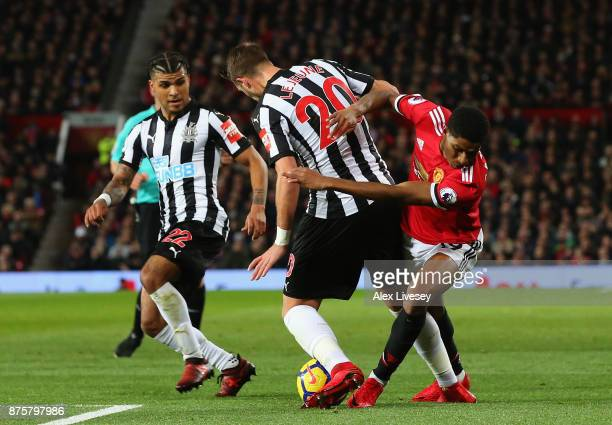 Florian Lejeune of Newcastle United and Marcus Rashford of Manchester United battle for possession during the Premier League match between Manchester...