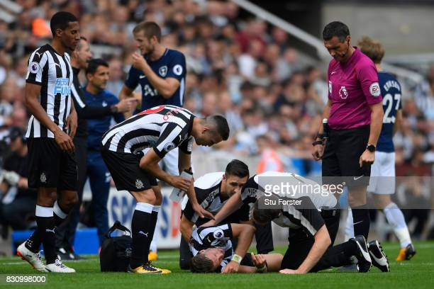Florian Lejeune of Newcastle United goes down injured after being fouled by Harry Kane of Tottenham Hotspur during the Premier League match between...
