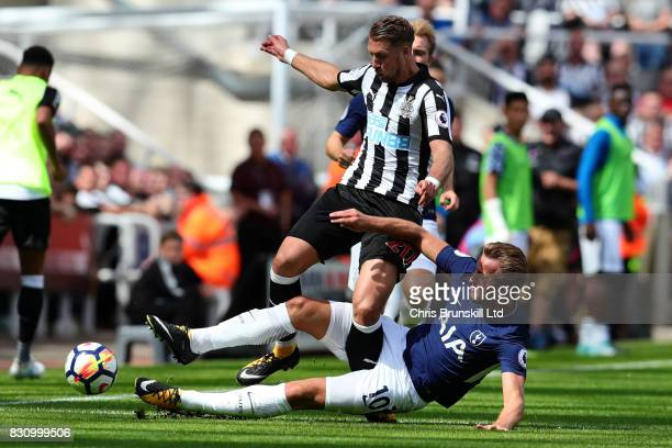 Florian Lejeune of Newcastle United is tackled by Harry Kane of Tottenham Hotspur during the Premier League match between Newcastle United and...