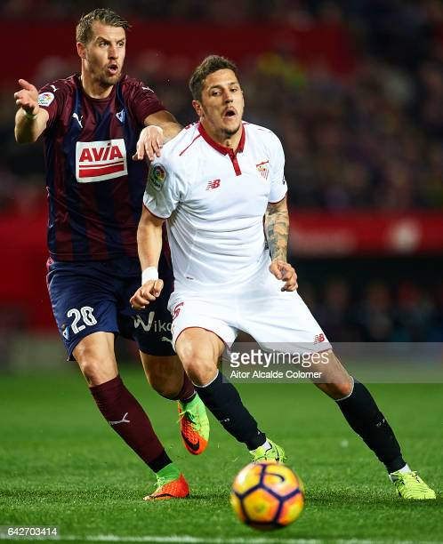 Florian Lejeune of SD Eibar competes for the ball with Stevan Jovetic of Sevilla FC during the La Liga match between Sevilla FC and SD Eibar at...