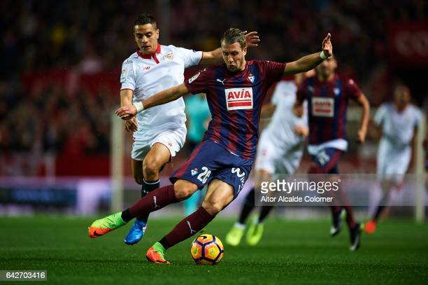Florian Lejeune of SD Eibar competes for the ball with Wissam Ben Yedder of Sevilla FC during the La Liga match between Sevilla FC and SD Eibar at...