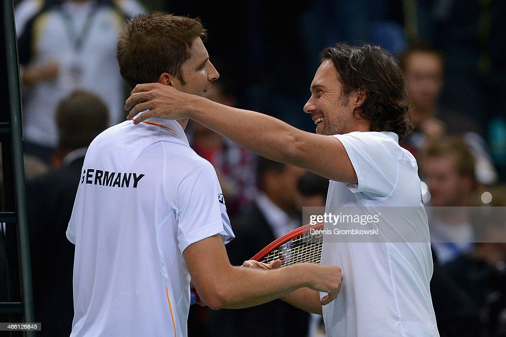 <a gi-track='captionPersonalityLinkClicked' href=/galleries/search?phrase=Florian+Mayer&family=editorial&specificpeople=206516 ng-click='$event.stopPropagation()'>Florian Mayer</a> of Germany and head coach Carsten Arriens hug on day 1 of the Davis Cup First Round match between Germany and Spain at Fraport Arena on January 31, 2014 in Frankfurt am Main, Germany.