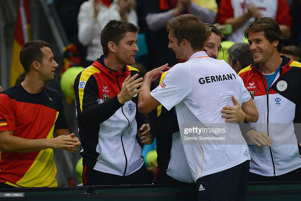 <a gi-track='captionPersonalityLinkClicked' href=/galleries/search?phrase=Florian+Mayer&family=editorial&specificpeople=206516 ng-click='$event.stopPropagation()'>Florian Mayer</a> of Germany celebrates after his match against Feliciano Lopez of Spain on day 1 of the Davis Cup First Round match between Germany and Spain at Fraport Arena on January 31, 2014 in Frankfurt am Main, Germany.