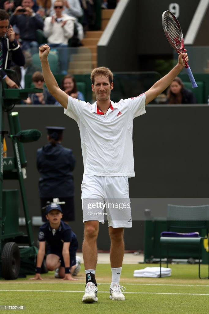 <a gi-track='captionPersonalityLinkClicked' href=/galleries/search?phrase=Florian+Mayer&family=editorial&specificpeople=206516 ng-click='$event.stopPropagation()'>Florian Mayer</a> of Germany celebrates winning his Gentlemen's Singles fourth round match against Richard Gasquet of France on day eight of the Wimbledon Lawn Tennis Championships at the All England Lawn Tennis and Croquet Club on July 3, 2012 in London, England.