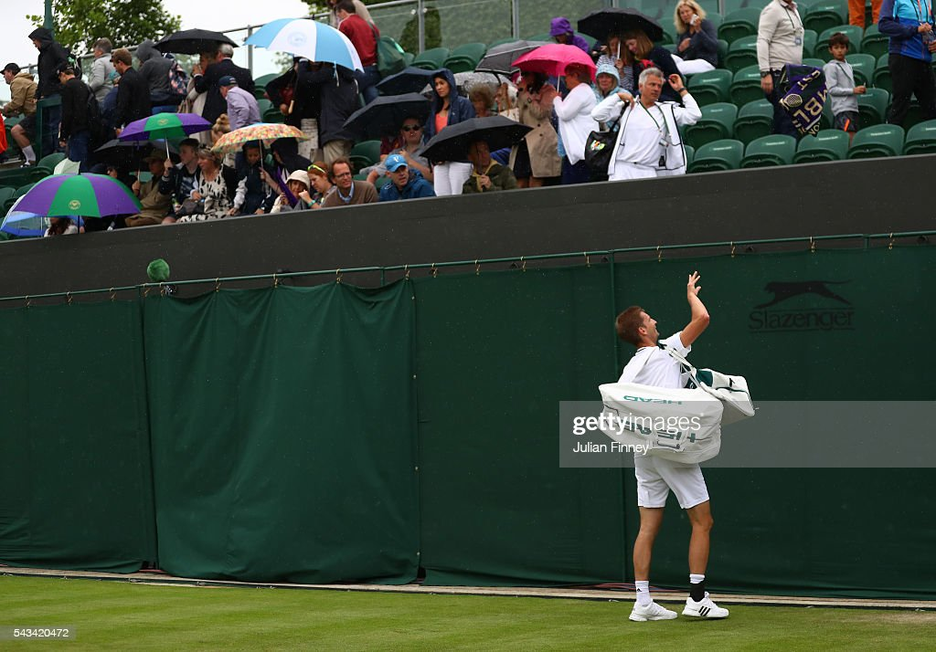 <a gi-track='captionPersonalityLinkClicked' href=/galleries/search?phrase=Florian+Mayer&family=editorial&specificpeople=206516 ng-click='$event.stopPropagation()'>Florian Mayer</a> of Germany gestures to the crowed during the Men's Singles first round match against Dominic Thiem of Austria on day two of the Wimbledon Lawn Tennis Championships at the All England Lawn Tennis and Croquet Club on June 28, 2016 in London, England.