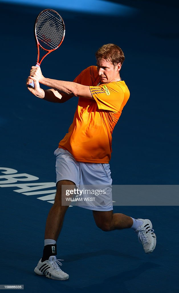 Florian Mayer of Germany hits a backhand return during his loss to Marcos Baghdatis of Cyprus in the second round at the Brisbane International tennis tournament on January 2, 2013. AFP PHOTO/William WEST USE