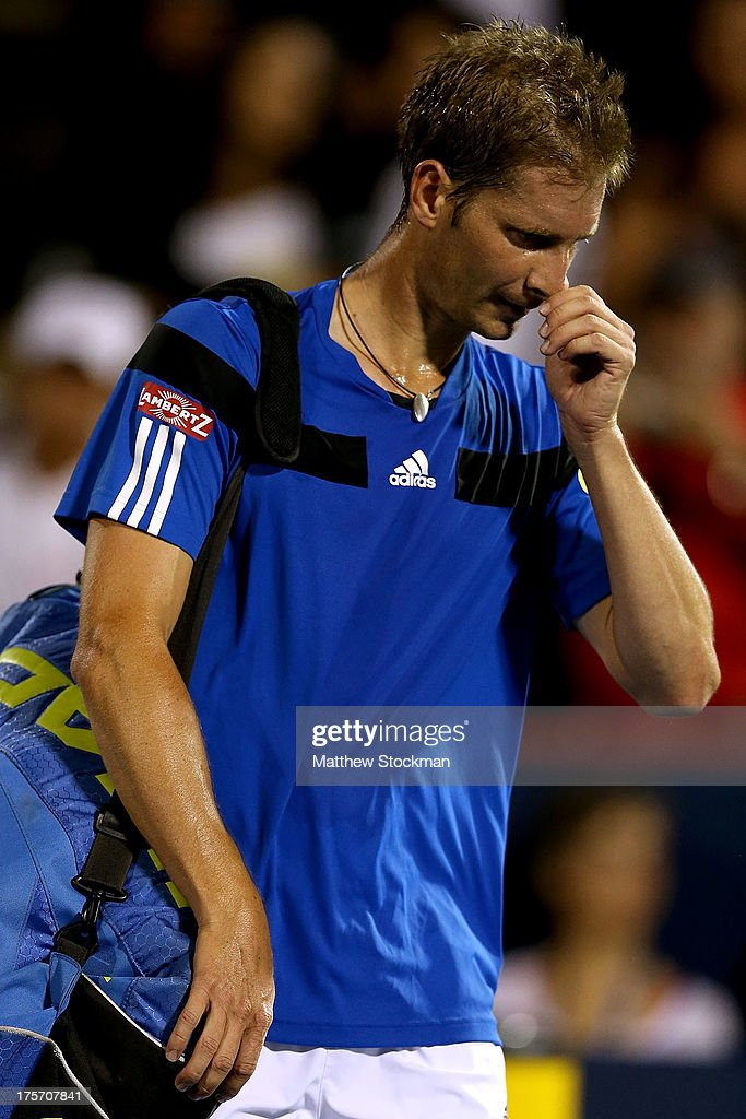 Florian Mayer of Germany leaves the court after losing to Novak Djokovic of Serbia during the Rogers Cup at Uniprix Stadium on August 6, 2013 in Montreal, Quebec, Canada.