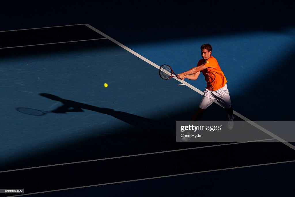 Florian Mayer of Germany plays a backhand during his match against Marcos Baghdatis of Cyrpus on day four of the Brisbane International at Pat Rafter Arena on January 2, 2013 in Brisbane, Australia.