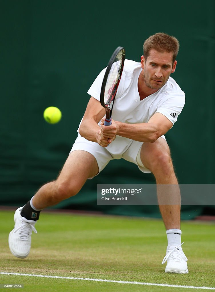 Florian Mayer of Germany plays a backhand during the Men's Singles first round match against Dominic Thiem of Austria on day three of the Wimbledon Lawn Tennis Championships at the All England Lawn Tennis and Croquet Club on June 29, 2016 in London, England.