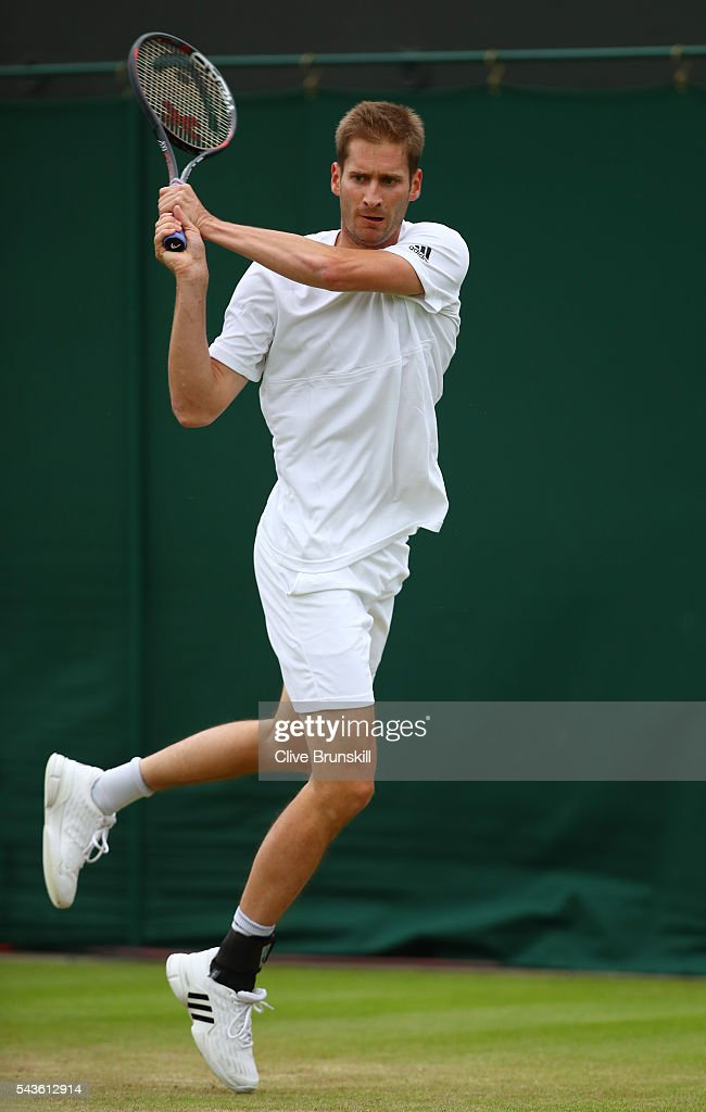 <a gi-track='captionPersonalityLinkClicked' href=/galleries/search?phrase=Florian+Mayer&family=editorial&specificpeople=206516 ng-click='$event.stopPropagation()'>Florian Mayer</a> of Germany plays a backhand during the Men's Singles first round match against Dominic Thiem of Austria on day three of the Wimbledon Lawn Tennis Championships at the All England Lawn Tennis and Croquet Club on June 29, 2016 in London, England.