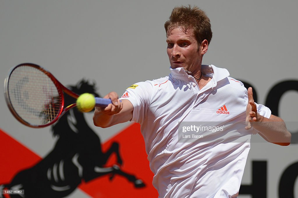 <a gi-track='captionPersonalityLinkClicked' href=/galleries/search?phrase=Florian+Mayer&family=editorial&specificpeople=206516 ng-click='$event.stopPropagation()'>Florian Mayer</a> of Germany plays a forehand during his match against Viktor Troicki of Serbia during day five of Power Horse World Team Cup at Rochusclub on May 24, 2012 in Duesseldorf, Germany.