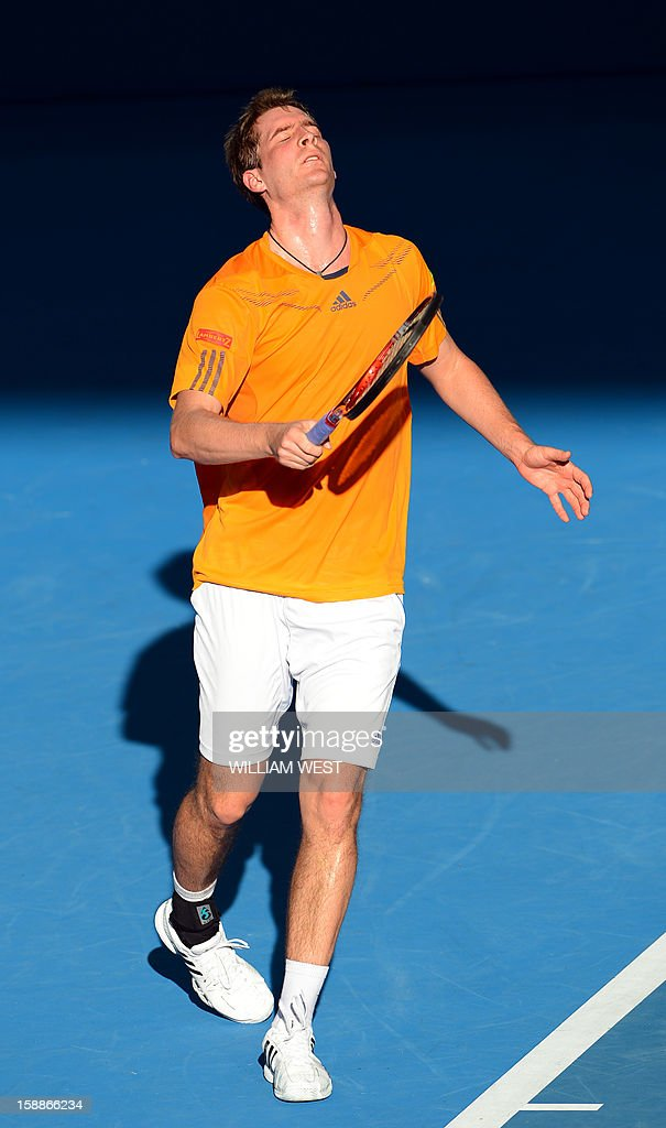 Florian Mayer of Germany reacts during his loss to Marcos Baghdatis of Cyprus in the second round at the Brisbane International tennis tournament on January 2, 2013. AFP PHOTO/William WEST USE