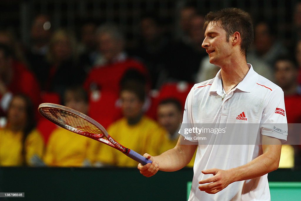 <a gi-track='captionPersonalityLinkClicked' href=/galleries/search?phrase=Florian+Mayer&family=editorial&specificpeople=206516 ng-click='$event.stopPropagation()'>Florian Mayer</a> of Germany reacts during his match against Juan Ignacio Chela of Argentina on day 3 of the Davis Cup World Group first round match between Germany and Argentina at Stechert Arena on February 12, 2012 in Bamberg, Germany.