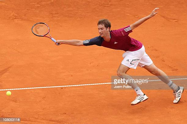 Florian Mayer of Germany returns a forehand during his Quarter Final match against Juan Carlos Ferrero of Spain during the International German Open...